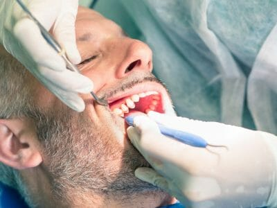 Man getting a root canal procedure done